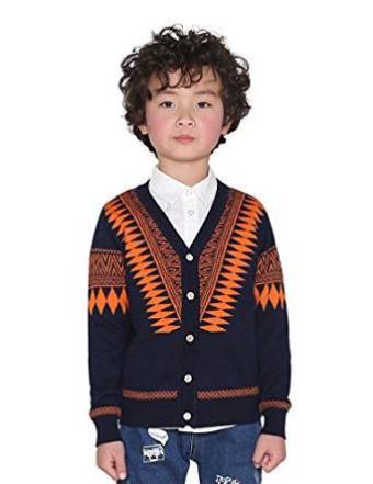 Boy wearing button cardigan over shirt