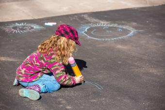 Young Girl Playing On Driveway