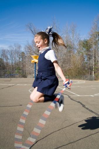 girl wearing pinafore dress