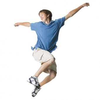 teen in tan shorts and blue shirt