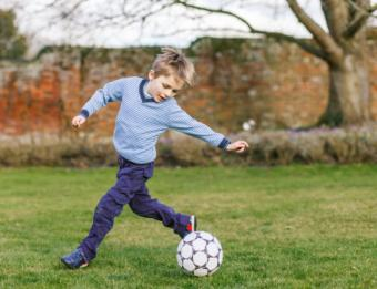 boy playing soccer in cool outfit