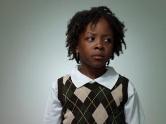 schoolboy wearing sweater vest