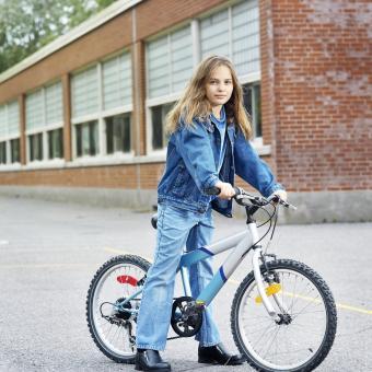 Girl wearing denim on a bicycle