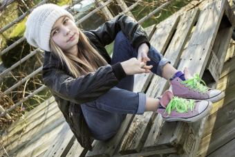 Cute grunge girl with hat and Converse
