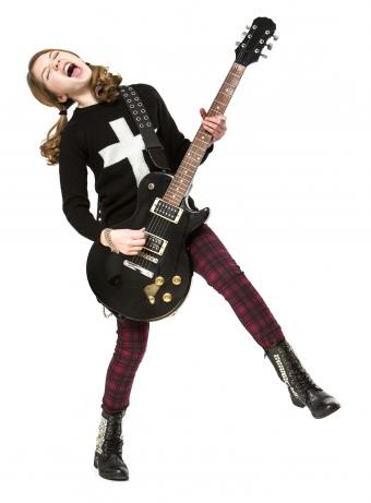 Goth girl playing the electric guitar