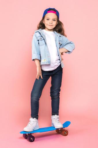 Tomboy girl in denim outfit