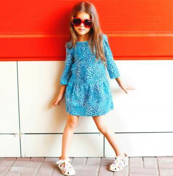 Girl wearing heart shaped sunglasses