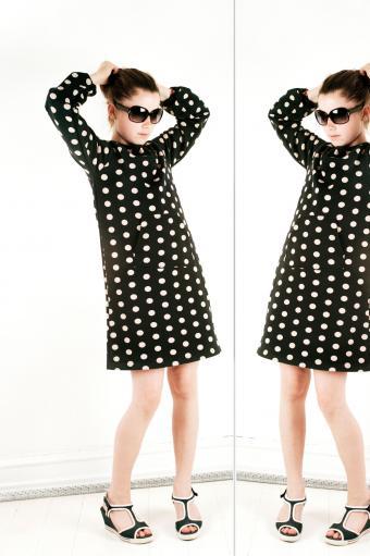 Girl in polka dotted black dress