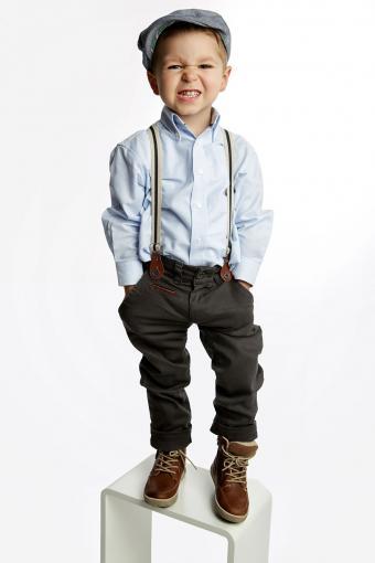 Boy wearing cap and suspenders