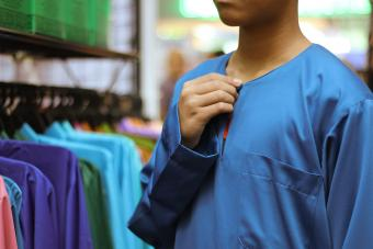 Boy Trying on Blue Shirt In Shop