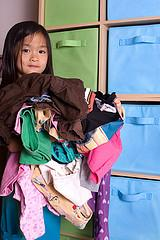Putting Kids Clothes in Bags for Each Day of the Week