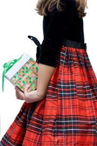 Girl in Christmas dress with present