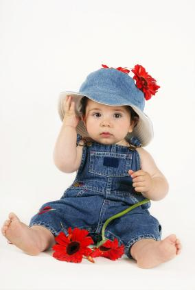 Little girl in denim with hat and flower
