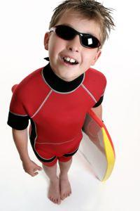 boy in red rash guard