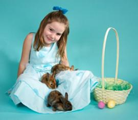girl in dress with bunnies