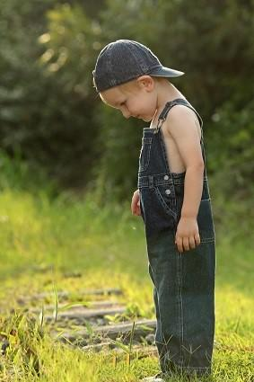 Boy in overalls