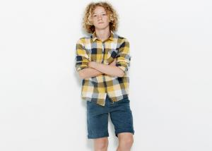 boy in plaid shirt and shorts