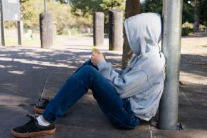 Teen wearing hoodie with jeans