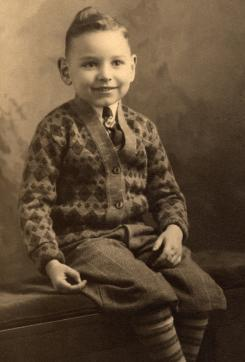 child with knit cardigan