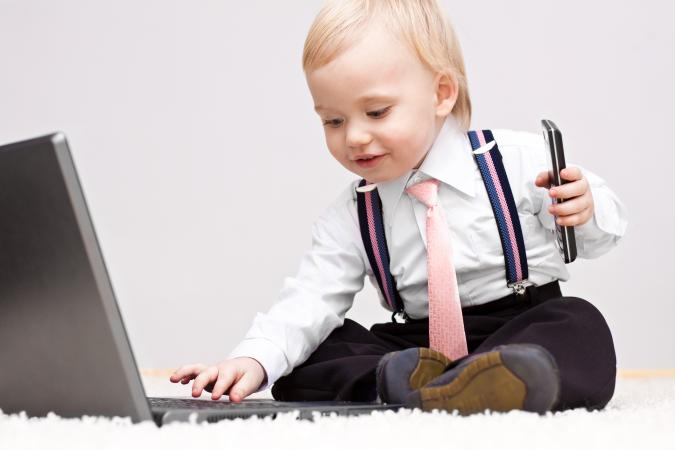 business baby with cellphone and laptop