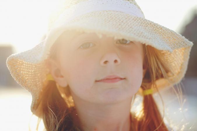 girl wearing a beach hat