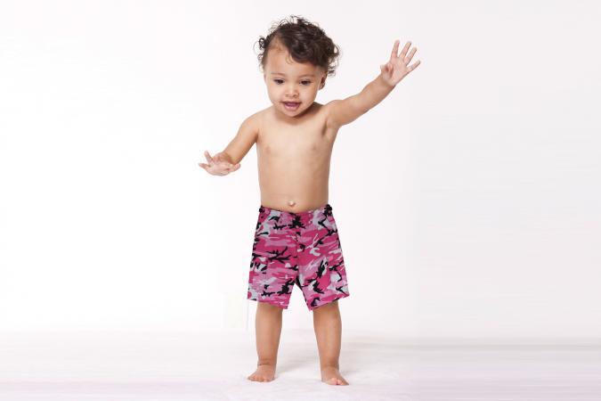 Toddler girl in pink camo shorts