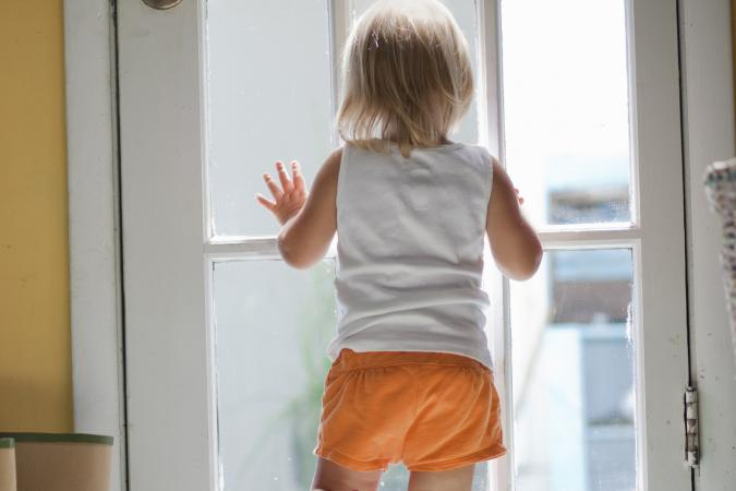 Toddler in orange shorts