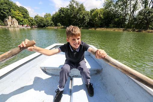 boy in boat wearing sporty clothes
