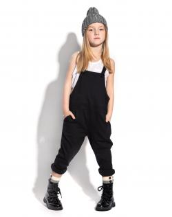 little girl wearing a jumpsuit