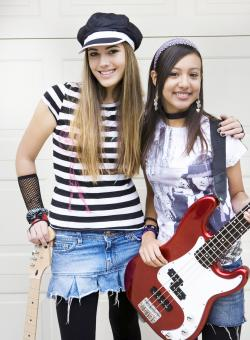 Teen girls with guitars