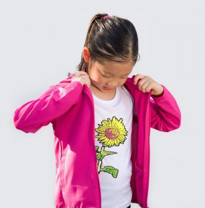 Girl wearing sunflower graphic tee