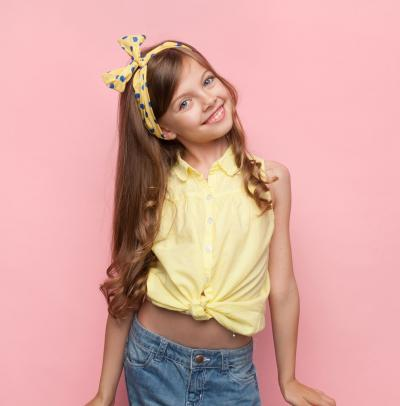 Girl wearing polka dot bow headband