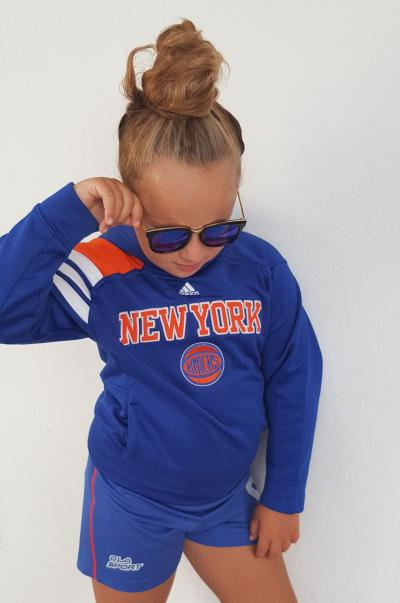 Girl in blue sporty sweat suit