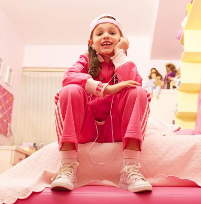 Girl in bright pink sweat suit