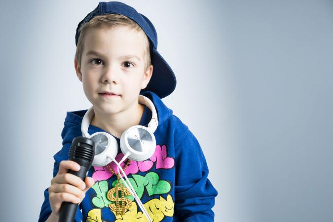 Boy with microphone and headphones
