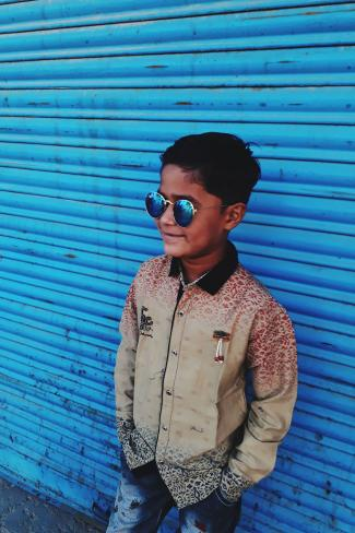 Boy in blue tinted sunglasses