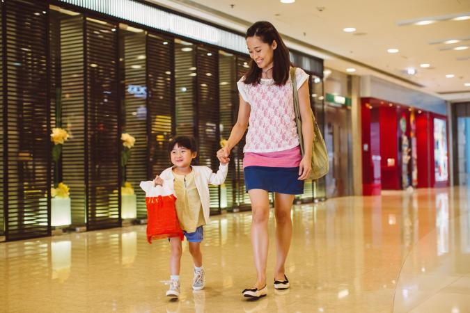 mother and child shopping in mall
