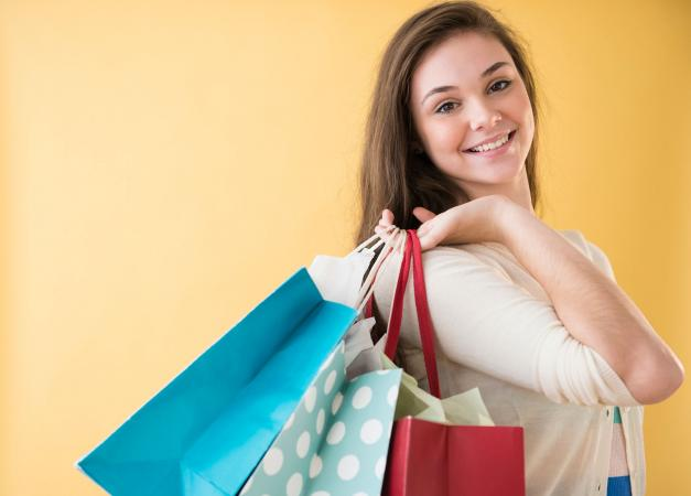 Teen girl carrying shopping bags