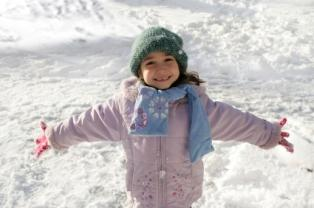 Girl in a pink winter jacket.