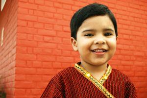 Indian boy in red and gold kurta