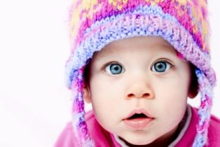 Baby girl in winter hat.