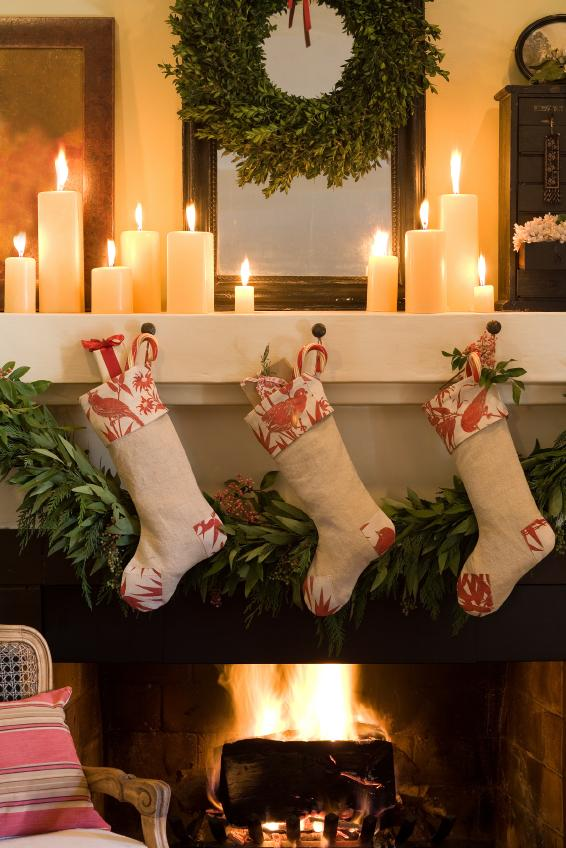 Decorating mantel for christmas with candles
