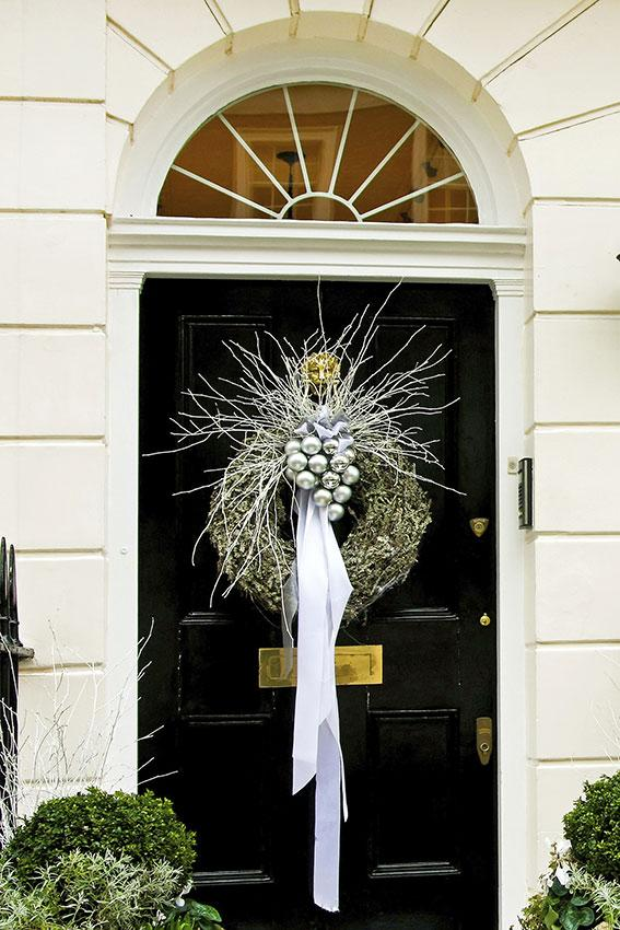silver wreath on door - Christmas Front Door Decor