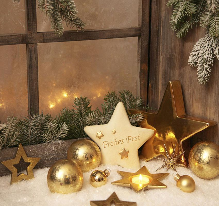 gold christmas ornaments on window sill