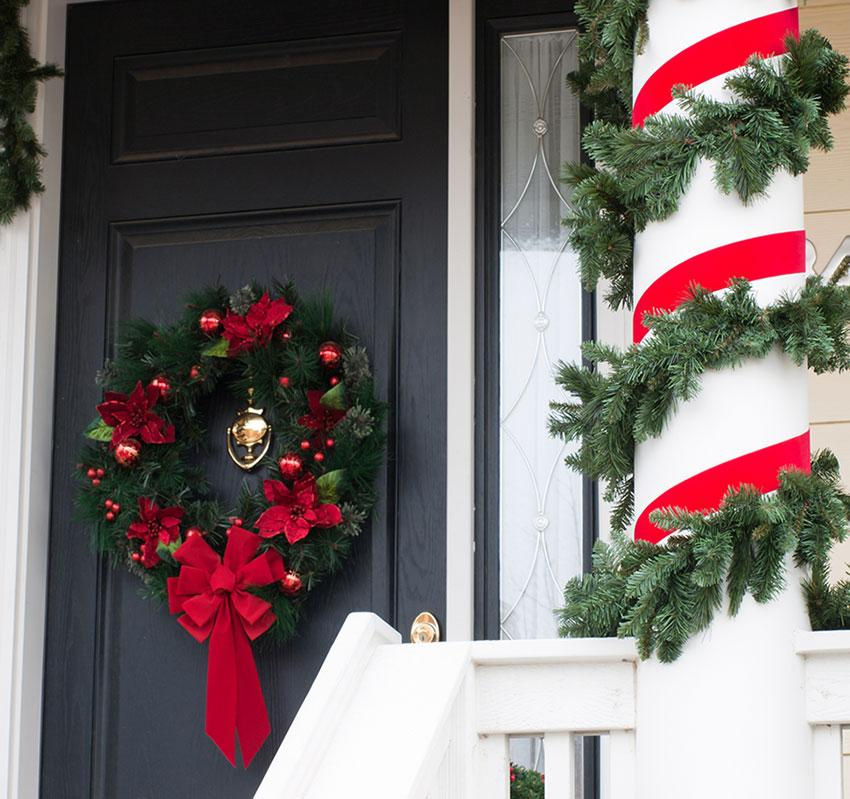 wreath and wrapped candy cane pole source christmas decorations - Christmas Column Decorations