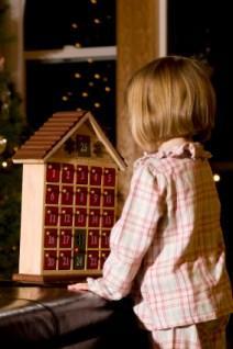 Girl looking at Advent calendar