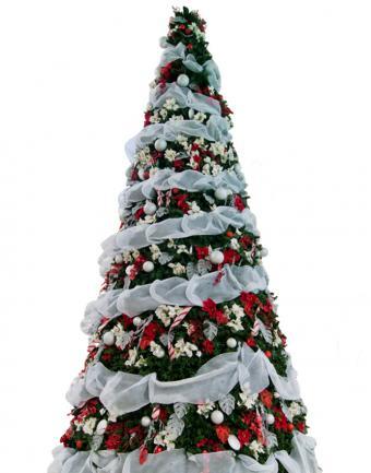 https://cf.ltkcdn.net/christmas/images/slide/183225-668x850-white-ribbon-chrismtas-tree.jpg