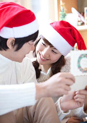 Couple reading romantic poetry in card together