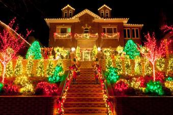 Home with lighted Christmas yard display