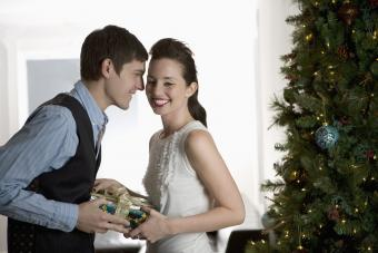 Man giving woman a Christmas gift